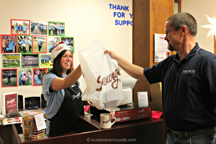Proud Watauga High band mom Sharon Houck makes a sale to a happy supporter!
